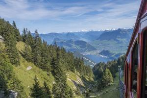 Cogwheel railway incline up Mt. Pilatus in Lucerne, Switzerland. by Michele Niles