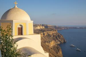 Domed church with steeple in town of Fira, Santorini, Greece. by Michele Niles