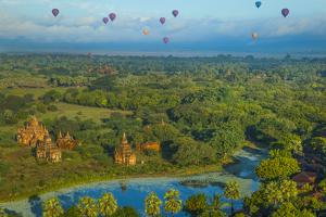 Hot air balloons, morning view of the temples of Bagan, Myanmar. by Michele Niles