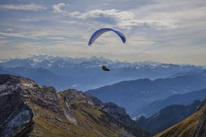 Lucerne, Switzerland. Paragliding off Mt. Pilatus. by Michele Niles