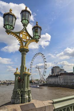 The London Eye and iconic British lamppost in London, England. by Michele Niles
