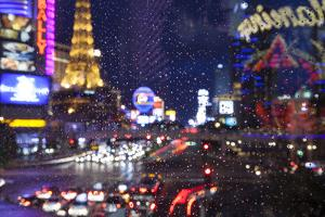 The Strip with Paris at Las Vegas main strip lights at night. by Michele Niles