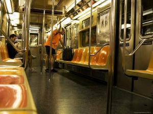 Man Looking at Map on Subway Train by Michelle Bennett