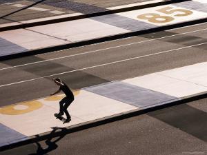 Teenage Boy Skateboarding on Road, Docklands by Michelle Bennett