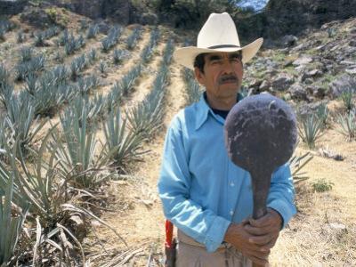 Tequila Plantation Worker, Mexico, North America by Michelle Garrett