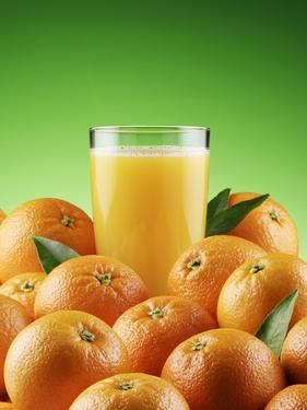 Orange Juice and Fresh Oranges by Miguel G. Saavedra