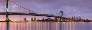 Panoramic View of the Ben Franklin Bridge and Philadelphia Skyline, under a Purple Sunset by Mihai Andritoiu