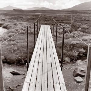 Wooden bridge over brook by Mika
