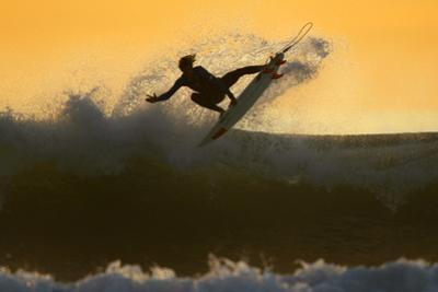 Young Surfer Sails His Board Off a Wave as Large Swells Hit the California Coastline