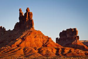 A Butte Emerges from the Desert Floor in Valley of the Gods, North of Mexican Hat, Utah by Mike Cavaroc