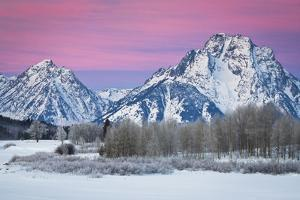 A Frozen Oxbow Bend Lies Below Mount Moran and the Tetons in Grand Teton National Park, Wyoming by Mike Cavaroc