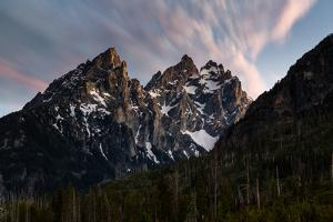 A Twilight Sky Glowing Above The Cathedral Group Of The Teton Mountains. Grand Teton NP, Wyoming by Mike Cavaroc