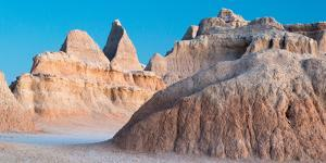 Abstract Forms In Eroded Sediment Of Badlands Illuminated With Light. Badlands NP, S Dakota by Mike Cavaroc