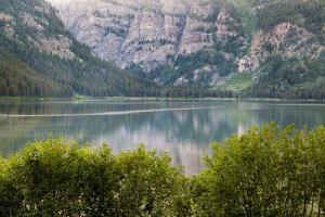 Phelps Lake Resting Below Death Canyon In The Teton Mountains. Grand Teton National Park, Wyoming by Mike Cavaroc