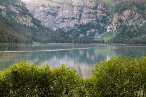 Phelps Lake Resting Below Death Canyon In The Teton Mountains. Grand Teton National Park, Wyoming by Mike Cavaroc