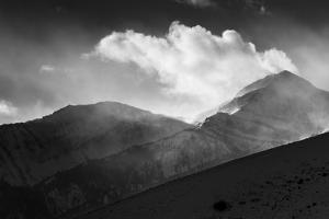Strong Winds Blow Snow Off Of The Peak Of Rendezvous Mountain Above Jackson Hole, Wyoming by Mike Cavaroc
