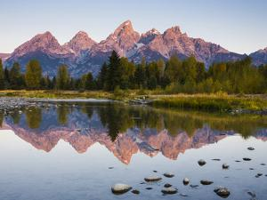 Sunrise on the Teton Mountains at Schwabacher Landing by Mike Cavaroc