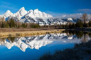 The Calm Waters Of A Side-Channel Of The Snake River Reflecting The Snow-Covered Teton Mountains by Mike Cavaroc