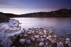 The Green River Flows Through Dinosaur National Monument, Utah as Snow Melts on Shores by Mike Cavaroc
