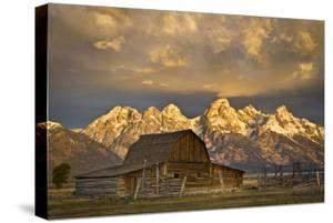 The Moulton Barn on Mormon Row Stands before a Fiery Sunrise in Grand Teton National Park, Wyoming by Mike Cavaroc