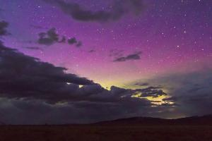 The Northern Lights Glow Above the Gros Ventre Mountains in Grand Teton National Park, Wyoming by Mike Cavaroc