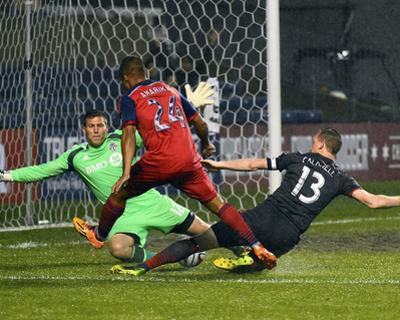 Jul 2, 2014 - MLS: Toronto FC vs Chicago Fire - Joe Bendik, Quincy Amarikwa by Mike Dinovo