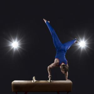 Male Gymnast Doing Handstand on Pommel Horse by Mike Harrington