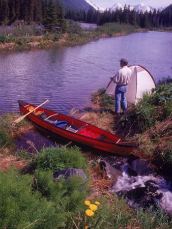 Man Camping and Fishing