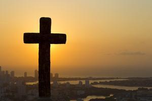 A Cross with the Cartagena Skyline in the Distance at Sunset by Mike Theiss