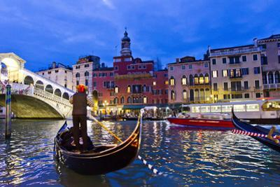 A Gondolier Guides His Boat and Passengers Toward the Rialto Bridge on the Grand Canal at Night by Mike Theiss