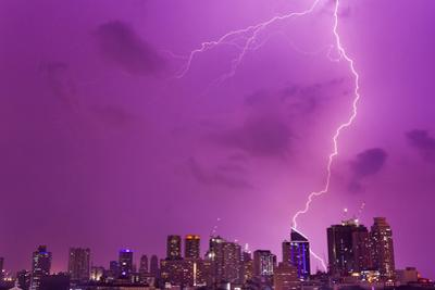 A Intense Thunderstorm with Lightning over the Skyline of Manila by Mike Theiss