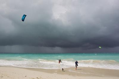 A Kiteboarder Enjoying Gusty Winds Created by Hurricane Tomas by Mike Theiss