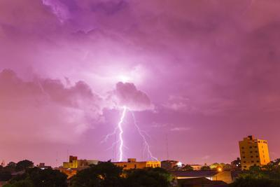 A Powerful Lightning Storm with Frequent Lightning Bolts Striking Downtown Asuncion by Mike Theiss