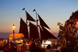 A Sailboat Carrying Tourists Returns to Port after a Sunset Sail by Mike Theiss