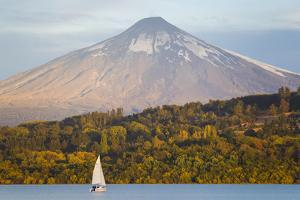 A Sailboat in Lake Villarrica Passes by the Villarrica Volcano by Mike Theiss