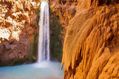 A Scenic View of Mooney Falls in the Havasupai Indian Reservation in Arizona by Mike Theiss