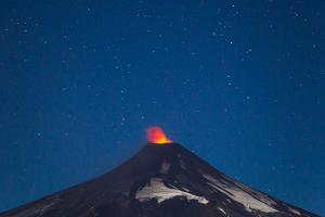 A Small Eruption of the Villarrica Volcano under a Night Sky Full of Stars by Mike Theiss