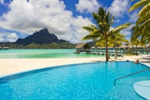 A Swimming Pool on the Beach at the Le Meridien Resort, with Mount Otemanu in the Distance by Mike Theiss