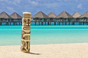 A Tiki Totem Pole on the Beach at the Le Meridien Resort by Mike Theiss