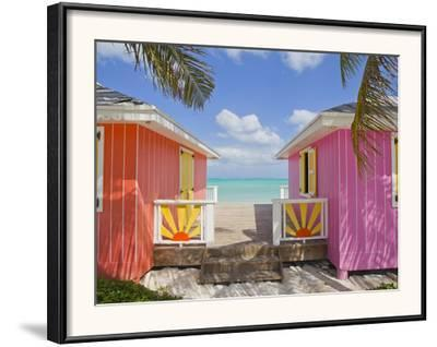 A Typical Tropical Scene with Colorful Buildings, Palms and Water by Mike Theiss