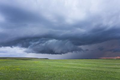 A wallcloud develops under a supercell thunderstorm. by Mike Theiss
