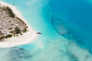 An Aerial View of Boat Pulled Ashore on a Private Island in the Turks and Caicos by Mike Theiss