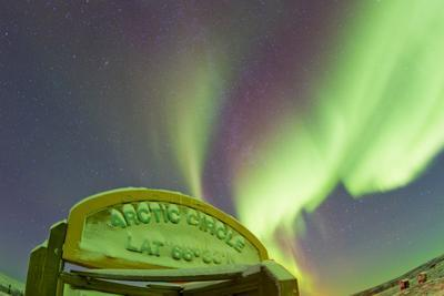 An Aurora Borealis at the Famous Arctic Circle Sign by Mike Theiss
