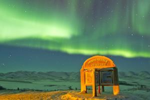 An Aurora Borealis Near the Famous Arctic Circle Sign by Mike Theiss