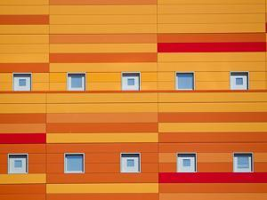 An Modern Building Decorated with Bright Orange Stripes by Mike Theiss