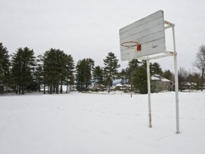 Basketball Court in a Vacant Lot Covered in Heavy Snow by Mike Theiss