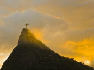 Christ the Redeemer Statue Atop Corcovado in Orange Glow at Sunset by Mike Theiss