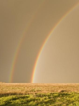 Double Rainbows on the Backside of a Thunderstorm in Tornado Alley by Mike Theiss