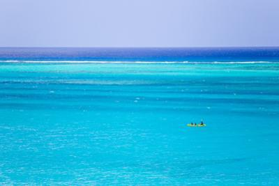 Kayakers in the Turquoise Waters of Grace Bay, in the Turks and Caicos Islands by Mike Theiss