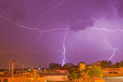 Multiple Lightning Bolts During an Intense Lightning Storm by Mike Theiss